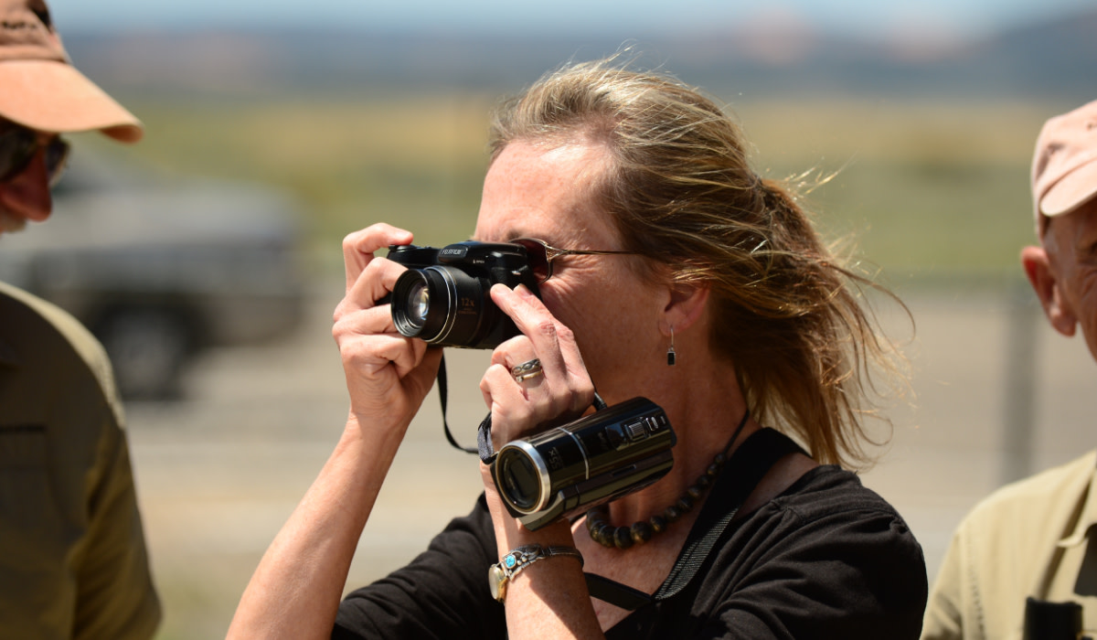 Woman taking a photo of Moab